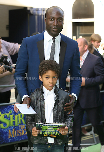 Ozwald Boateng and son Oscar attending the Shrek The Musical Press Night, at the The Theatre Royal, London. 14/06/2011  Picture by: Alexandra Glen / Featureflash