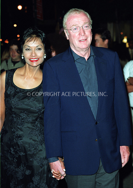 """Michael Caine and his wife attending the New York Premiere of """"Austin Powers in Goldmember"""" at Barney's New York on Madison Avenue in New York. July 24, 2002. Please byline: Alecsey Boldeskul/NY Photo Press.   ..*PAY-PER-USE*      ....NY Photo Press:  ..phone (646) 267-6913;   ..e-mail: info@nyphotopress.com"""