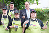 Stephen Hammond, Conservative parliamentary candidate for Wimbledon and the former parliamentary under-secretary of State for Transport is on the general election campaign trail in Wimbledon today (Monday 15th May 2017). <br /> <br /> Visiting the Merton Mencap Caf&eacute;, open every Monday at Holy Trinity Church in The Broadway it offers a range of healthy home-made dishes &amp; is run by adults with a learning disability, supported by Merton Mencap staff and volunteers. <br /> <br /> Hammond who has an 11,408 majority (24.1%) met some of the workers who have learning disabilities including <br /> <br /> L to R: <br /> <br /> back row:<br /> Richard Dorris ; Stephen Hammond <br /> <br /> front row:<br /> <br /> George Cary ; Neil Weddell ; Anna Caldicott<br /> <br /> <br /> <br /> Photograph by Elliott Franks <br /> Image licensed to Elliott Franks Photography Services