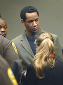 Convicted sniper John Allen Muhammad, looks back to his atttorney's after a bench conference at the end of the testimony of his ex-wife, Mildred, during the penalty phase of his trial in Virginia Beach Circuit Court in Virginia Beach, Virginia on November 19, 2003.   Now in the punishment phase of the trial, the jury can only choose execution or life in prison without parole for Muhammad, who was found guilty Monday, November 17, 2003 of all charges, including two capital murder counts, in one of 10 fatal shootings that terrorized the Washington, D.C., area in 2002. <br /> Credit: Tracy Woodward - Pool via CNP