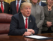 United States President Donald J. Trump signs a bipartisan bill to stop the flow of opioids into the United States in the Oval Office of the White House in Washington, DC on Wednesday, January 10, 2018.<br /> Credit: Ron Sachs / Pool via CNP