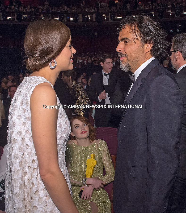 22.02.2015; Hollywood, California: 87TH OSCARS - MARION COTILLARD CHATS TO ALEJANDRO INARRITU WHILE EMMA STONE <br /> cuddle a &quot;Lego Oscar&quot;, during the Annual Academy Awards Telecast, Dolby Theatre, Hollywood.<br /> Mandatory Photo Credit: NEWSPIX INTERNATIONAL<br /> <br />               **ALL FEES PAYABLE TO: &quot;NEWSPIX INTERNATIONAL&quot;**<br /> <br /> PHOTO CREDIT MANDATORY!!: NEWSPIX INTERNATIONAL(Failure to credit will incur a surcharge of 100% of reproduction fees)<br /> <br /> IMMEDIATE CONFIRMATION OF USAGE REQUIRED:<br /> Newspix International, 31 Chinnery Hill, Bishop's Stortford, ENGLAND CM23 3PS<br /> Tel:+441279 324672  ; Fax: +441279656877<br /> Mobile:  0777568 1153<br /> e-mail: info@newspixinternational.co.uk