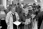 Residents sing at the 10th anniversary AGM of Walterton and Elgin Community Homes, (WECH), the resident-controlled housing association which over the two estates from Westminster Council.