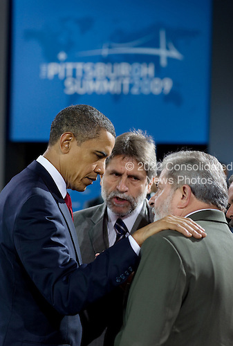 Pittsburgh, PA - September 25, 2009 -- United States President Barack Obama and President Luiz Inacio Lula da Silva of Brazil talk during the morning plenary session of the G-20 Pittsburgh Summit at the David L. Lawrence Convention Center in Pittsburgh, Pennsylvania, September 25, 2009. .Mandatory Credit: Pete Souza - White House via CNP