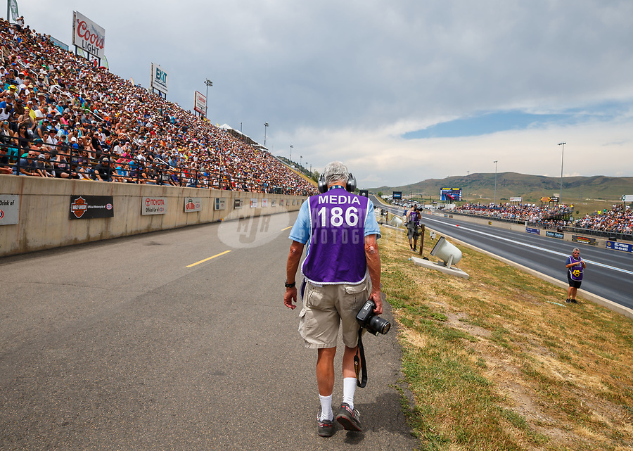 Jul 23, 2017; Morrison, CO, USA; NHRA photographer Jon Asher during the Mile High Nationals at Bandimere Speedway. Mandatory Credit: Mark J. Rebilas-USA TODAY Sports