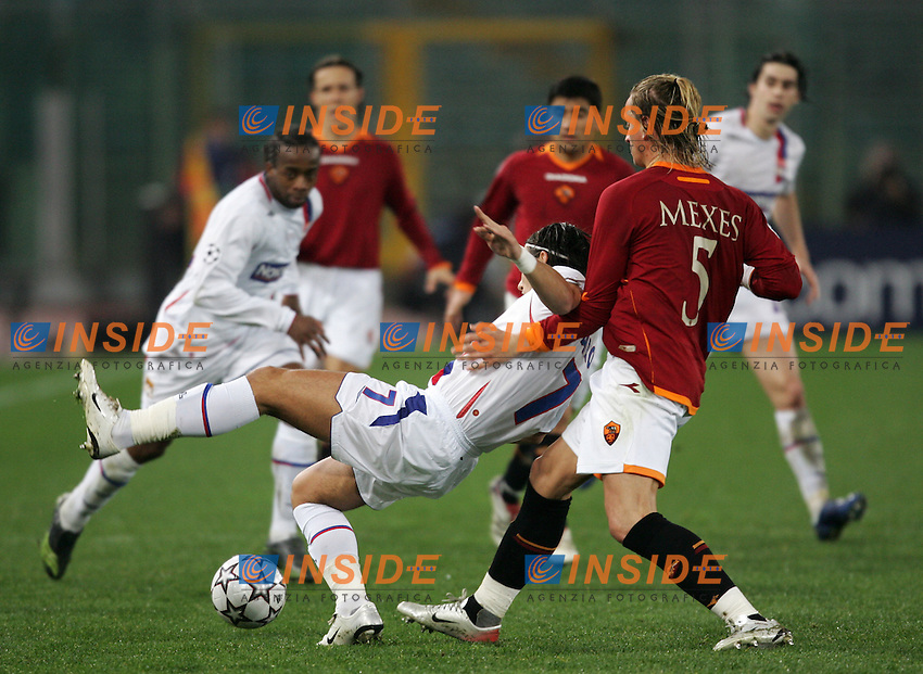 Philippe Mexes (Roma), Milan Baros (Olympique Lyonnais)<br /> Champions League 2006-2007<br /> 21 Feb 2007 (First knockout round)<br /> Roma - Olympique Lyonnaise (0-0)<br /> &quot;Olimpico&quot; Stadium - Roma - Italy<br /> Photographer: Andrea Staccioli Inside Roma Olympique Lyon