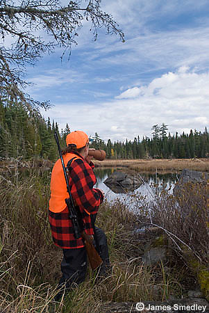 Hunter calling with a moose call