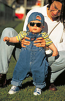 Mother, Christine, holds her baby Alexander in the park, babies, boy, boys. Alexander and Mom. Santa Monica California.