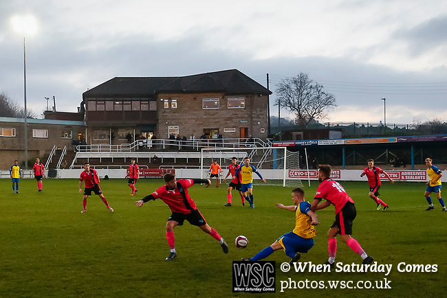 Stocksbridge attack with the club house in the background. Stocksbridge Park Steels v Pickering Town, Evo-Stik East Division, 17th November 2018. Stocksbridge Park Steels were born from the works team of the local British Steel plant that dominates the town north of Sheffield.<br /> Having missed out on promotion via the play offs in the previous season, Stocksbridge were hovering above the relegation zone in Northern Premier League Division One East, as they lost 0-2 to Pickering Town. Stocksbridge finished the season in 13th place.