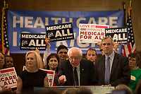 """United States Senator Bernie Sanders (Independent of Vermont), center, announces he has introduced a new version of his """"Medicare for All"""" plan at a press conference on Capitol Hill in Washington DC on April 10, 2019.  He is joined by US Senator Kirsten Gillibrand (Democrat of New York), left, and US Senator Edward Markey (Democrat of Massachusetts), right.  The Sanders plan will replace job-based and private health insurance with a government plan that guarantees coverage, including long-term care, for all citizens. Photo Credit: Stefani Reynolds/CNP/AdMedia"""
