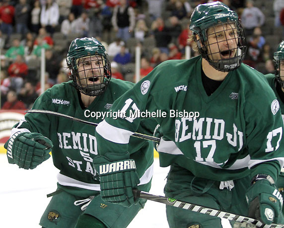 Bemidji State's Matt Carlson (No. 5) and Jamie MacQueen skate toward their bench to celebrate MacQueen's goal during the third period. Bemidji State beat UNO 4-2 Friday night during the first round of the WCHA playoffs at Qwest Center Omaha. (Photo by Michelle Bishop)