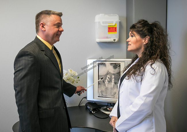Dr. Meighen and Jennifer Stroshine at the Spine Nevada office in Sparks on March 8, 2017.