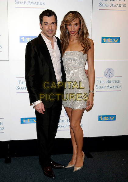 STEVE BROOKSTEIN & JAVINE.British Soap Awards - Press Room.BBC Television Centre, W12, London.May 7th, 2005.Ref: PL.full length strapless silver dress brown suit jewel encrusted.www.capitalpictures.com.sales@capitalpictures.com.©Capital Pictures.