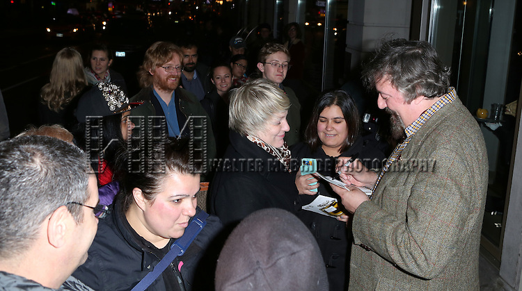 Stephen Fry greets fans at the stage door after the Broadway Opening Night Performance of 'Twelfth Night' at the Belasco Theatre on November 10, 2013 in New York City.