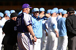 CHAPEL HILL, NC - FEBRUARY 27: UNC head coach Mike Fox (right) and High Point head coach Craig Cozart (38). The University of North Carolina Tar heels hosted the High Point University Panthers on February 27, 2018, at Boshamer Stadium in Chapel Hill, NC in a Division I College Baseball game. UNC won the game 10-0.