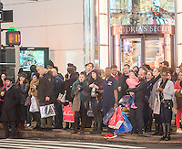 Last minute shoppers in Herald Square with their purchases in New York on Tuesday, December 22, 2015. (© Richard B. Levine)