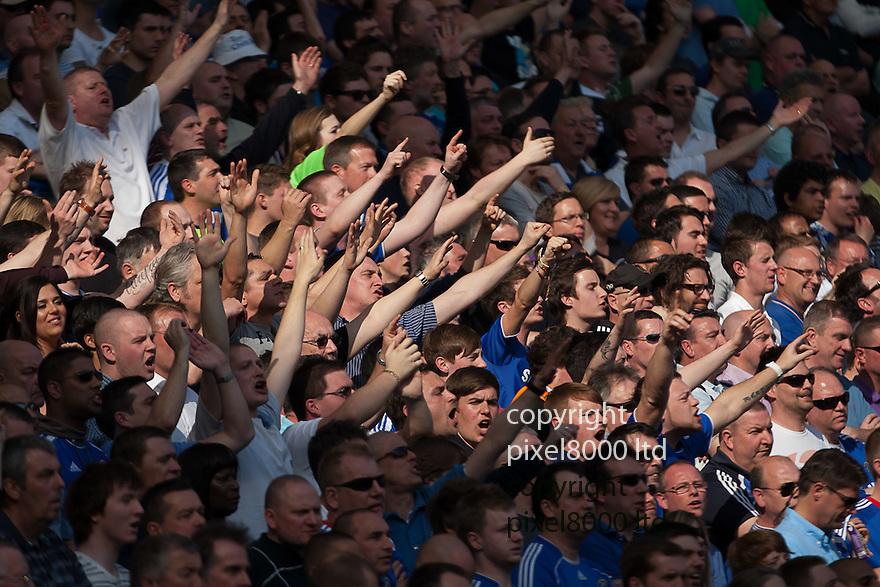 London, UK. Chelsea home crowd jeering Tottenham's travelling fans during Barclays Premier League fixture Chelsea versus Tottenham Hotspur at Stamford Bridge 24 Mar.  Byline David Fearn Pixel 8000 Ltd