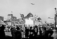 "Crowd scene at Chicago World's Fair.  Entrance to ""Auto Skooter"" and Oriental village in background.(Photographer Unknown/www.bcpix.com)"
