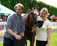 Edged Out is given water in the winners enclosure after winning The Think Cars Ssangyong Paddock Area Display Handicap, during Father's Day Racing at Salisbury Racecourse on 18th June 2017