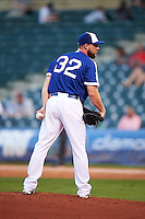 Oklahoma City Dodgers pitcher Ryan Dennick (32) looks in for the sign during a game against the Fresno Grizzles on June 1, 2015 at Chickasaw Bricktown Ballpark in Oklahoma City, Oklahoma.  Fresno defeated Oklahoma City 14-1.  (Mike Janes/Four Seam Images)