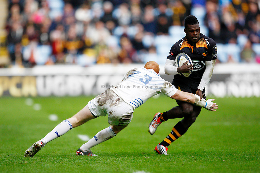 Photo: Richard Lane/Richard Lane Photography. Wasps v Leinster Rugby.  European Rugby Champions Cup. 24/01/2015. Wasps' Christian Wade breaks from Leinster's Darragh Fanning.