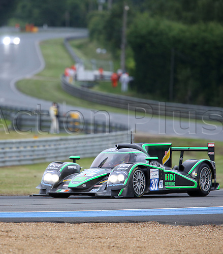 14.06.2012. Le Mans, France. The LMP2 class Lola - Judd of Status Grand Prix with drivers Alexander Sims, Yelmer Buurman and Romain Iannetta in action during the qualifying for the 80th 24 Hours Race of Le Mans on the Circuit de la Sarthe in Le Mans, France 14 June 2012.