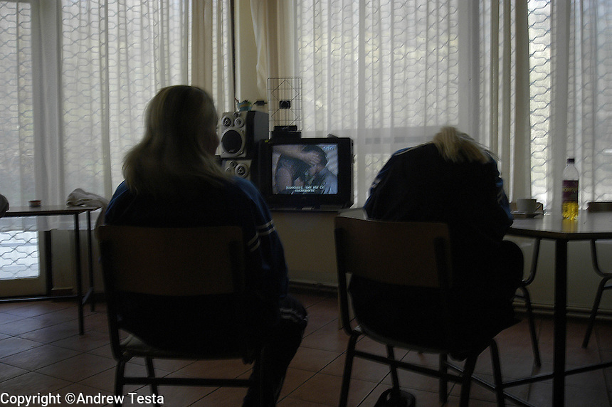 MACEDONIA. Skopje. 06 Feb 2003..Trafficked women from Moldova, who were taken from brothels during police raids, watch tv in a Government safehouse in the capital Skopje. They are held here while they wait to be returned to their countries..©Andrew Testa/Panos for Newsweek