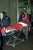 December 6, 1989 File Photo - Paramedic evacuates wounded students from Ecole Polytechnic (school) after Twenty-five-year-old Marc Lepine, armed with a legally obtained Mini-14 rifle and a hunting knife, shot twenty-eight people before killing himself.<br /> <br /> Photo : (c) Rob Gallbraith, 1989