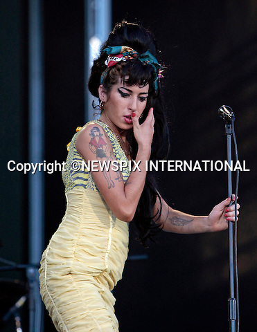 """AMY WINEHOUSE_ .Found dead at her apartment today_23/07/2011..During a performances she looked a bit unsteady on her feet as she knocked back a glass of red wine when she performed at the Rock In Rio Festival, Arganda del Rey, Madrid_05/07/2008.Mandatory Credit Photo: ©Martinez-NEWSPIX INTERNATIONAL..**ALL FEES PAYABLE TO: """"NEWSPIX INTERNATIONAL""""**..IMMEDIATE CONFIRMATION OF USAGE REQUIRED:.Newspix International, 31 Chinnery Hill, Bishop's Stortford, ENGLAND CM23 3PS.Tel:+441279 324672  ; Fax: +441279656877.Mobile:  07775681153.e-mail: info@newspixinternational.co.uk"""