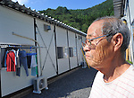 September 9, 2011, Kamaishi, Japan - Minoru Ueno lives in a temporary housing in Toni, Iwate Prefecture, some 450km northeast of Tokyo, on Friday, September 9, 2011. The 76-year-old miraculously has survived tsunami that swallowed up his house following an earthquake that shook much of Japan's northeastern region on March 11, 2011. Nearly six months after the worst disaster Japan has ever experienced, recovery and reconstruction efforts has progressed in much of the northeastern region, although its still too far from what this area rich in culture and tradition once was. The death toll reaches over 15,000 with more than 4,500 people still missing. according to the National Police Agency. (Photo by Natsuki Sakai/AFLO) [3615] -mis-