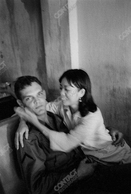 The Vietnam War, US soldier with Vietnamese prostitute, South Vietnam, November 1967