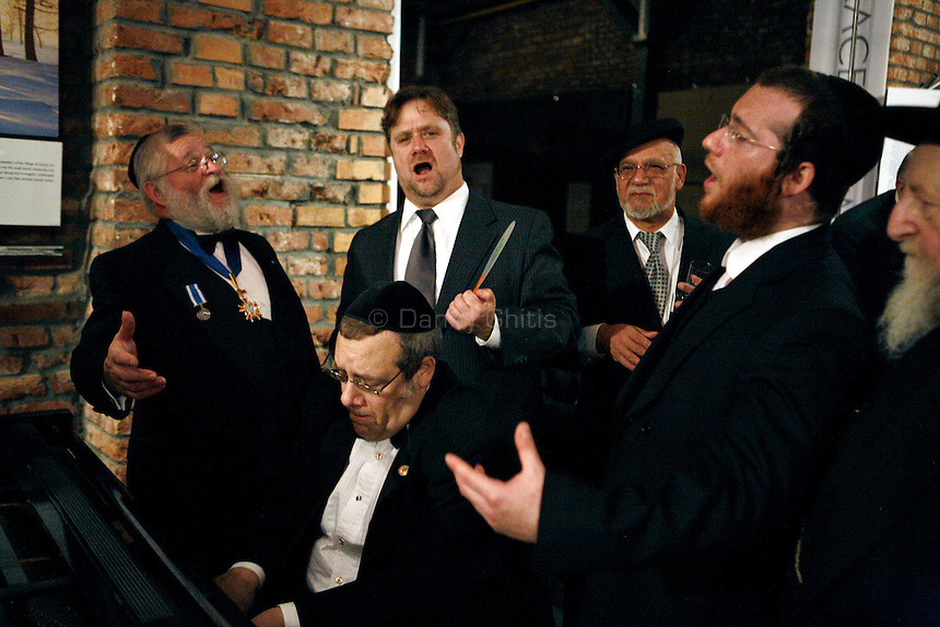 A group of cantors belt harmonies during a reception at the Galicja Jewish Museum in Kazimerz. <br /> <br /> Before the fall of communism in Poland, the former Jewish neighborhood of Kazimerz in Krakow was run down and dangerous to visit at night. Today, the area draws thousdands of tourists a year from around the world. The neighborhood was once a bustling center of Jewish life before it was wiped out during WWII. Jewish-themed restaurants and cafes serve traditional Jewish and Polish cuisine and restored synagogues contain exhibits detailing pre-war Jewish life in Poland. Some controversy exists over anti-Semitic paintings and woodwork in some gift shops and restaurants. Kazimerz is also the center of Krakow's night life, where tourists and students visit a variety of bars and night clubs. Klezmer music has seen a comeback as well, and musicians play concerts weekly. A short walk across the river to the south takes you to the former wartime ghetto and Oscar Schindler's factory, famously depicted in Steven Spielberg's film Schindler's List. The film was one of the determining factors in bringing attention to the Kazimerz district, resulting in massive restoration efforts.