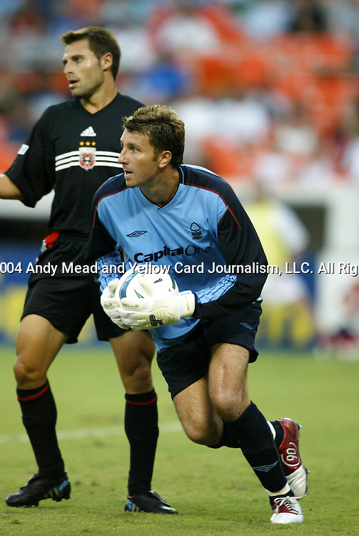 14 July 2004: Forest goalkeeper Darren Ward (right) scoops up the ball in front of Dema Kovalkenko. DC United defeated Nottingham Forest of England First Division 4-3 on penalties after the teams played to a 1-1 draw at RFK Stadium in Washington, DC during an international exhibition match..