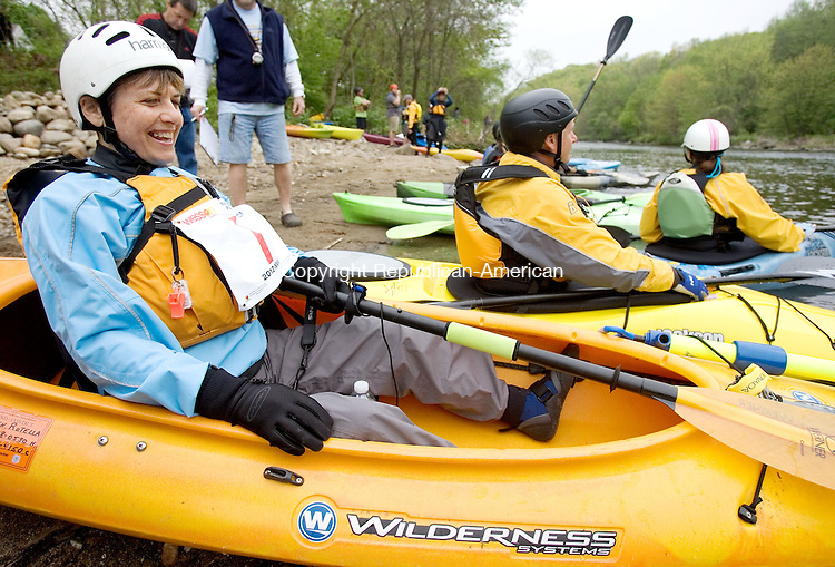 WATERBURY, CT. 05 May 2012-050512SV08-Karen Rotella of Middlebury gets ready to shove off during the fifth annual Naugatuck Valley River Race on the Naugatuck River in Waterbury Saturday. Two popular Naugatuck Valley events, the fifth annual River Race and the 14th annual Riverfest Duck Race, combined this year. The paddling ended six miles south before the Depot Street Bridge in Beacon Falls where the duck race took place..Steven Valenti Republican-American