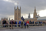 "Protestors cross over Westminster Bridge at the end of  the ""Put it to the People"" rally which made it's way through central London today. Demonstrators from across the country gathered to call for a second referendum on Brexit and to march through the UK capital finishing with speeches in Parliament Square opposite the Houses of Parliament in Westminster."