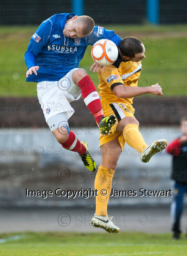 Cowdenbeath's Kenny Adamson and Dumbarton's Chris Turner challenge for the ball ?