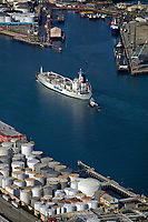 aerial photograph of a tug boat escorting the NYKCool Santa Lucia containership at the Port of Los Angeles, Los Angeles County, California