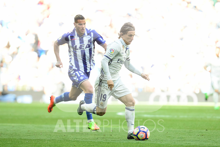 Real Madrid's Luka Modric and Deportivo Alaves's Theo Hernandez during La Liga match between Real Madrid and Deportivo Alaves at Stadium Santiago Bernabeu in Madrid, Spain. April 02, 2017. (ALTERPHOTOS/BorjaB.Hojas)