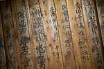 "Photo shows the ""gakuya"" dressing room area of Korakukan theater, Japan's oldest extant wooden playhouse in Kosaka, Akita Prefecture Japan on 19 Dec. 2012. On the walls is the graffiti -- written by actors -- for which the theater is also famed. Photographer: Robert Gilhooly"