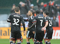 Washington D.C. - March 29, 2014: Fabian Espindola (9) of D.C. United celebrates his score with teammates.  The Chicago Fire tied D.C. United 2-2 during a Major League Soccer match for the 2014 season at RFK Stadium.