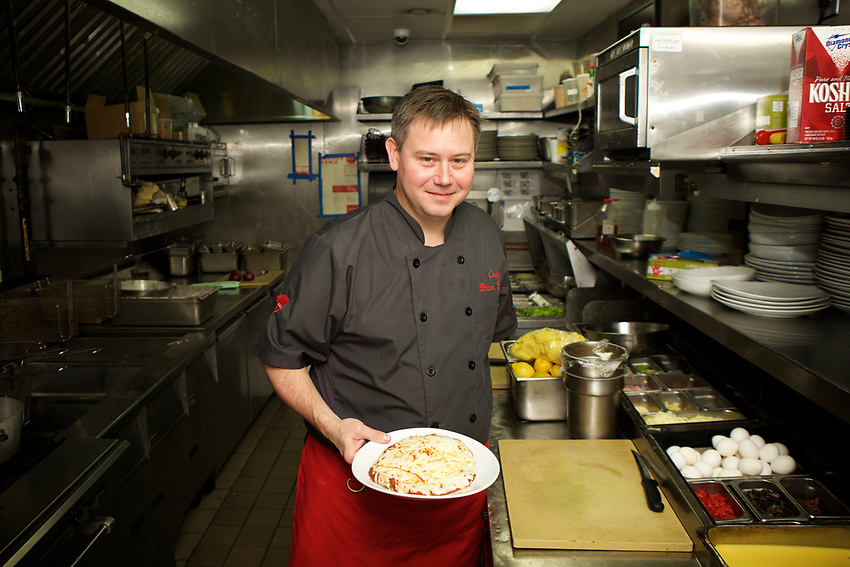 Queens, NY - July 9, 2017:  Executive Chef Brian Fisher in the kitchen at Allora Italian Kitchen and Bar in Bayside.<br />