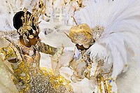 The flag bearer and the master of ceremony of a samba school perform during the Carnival Access Group parade at the Sambadrome in Rio de Janeiro, Brazil, 19 February 2012. The Carnival in Rio de Janeiro, considered the biggest carnival in the world, is a colorful, four day celebration, taking place every year forty days before Easter. The Samba school parades, featuring thousands of dancers, imaginative costumes and elaborate floats, are held on the Sambadrome, a purpose-built stadium in downtown Rio. According to costumes, flow, theme, band music quality and performance, a single school is declared the winner of the competition.