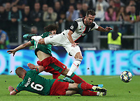 Football Soccer: UEFA Champions League -Group Stage-  Group D - Juventus vs Lokomotiv Moskva, Allianz Stadium. Turin, Italy, October 22, 2019.<br /> Juventus' Miralem Pjanic (top) in action with Locomotiv Moskva's Grzegorz Krychowiak (c) and Dmitri Barinov (bottom) during the Uefa Champions League football soccer match between Juventus and Lokomotiv Moskva at Allianz Stadium in Turin, on October 22, 2019.<br /> UPDATE IMAGES PRESS