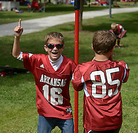 NWA Democrat-Gazette/BEN GOFF @NWABENGOFF<br /> Zayde Hickman (left), 8, and Hayden Alpe, 7, of Fayetteville celebrates a point while playing games with friends on Saturday Sept. 19, 2015 while tailgating before the Arkansas football game against Texas Tech in Fayetteville.