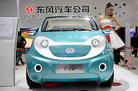 A model poses next to Dongfeng Motor Group Co.'s I-Car concept vehicle, displayed at the Beijing Auto Show in Beijing, China. The car show has attracted all the world's major auto markers. China's vehicle sales have breached the 10-million barrier for the first time ever, with 10.9 million automobiles sold last year. .24 Apr 2010