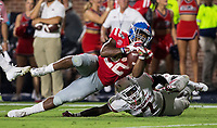 NWA Democrat-Gazette/BEN GOFF @NWABENGOFF<br /> Montaric Brown, Arkansas cornerback, and Joe Foucha, free safety, take down Scottie Phillips, Ole Miss running back, at the one yard line in the third quarter Saturday, Sept. 7, 2019, at Vaught-Hemingway Stadium in Oxford, Miss.