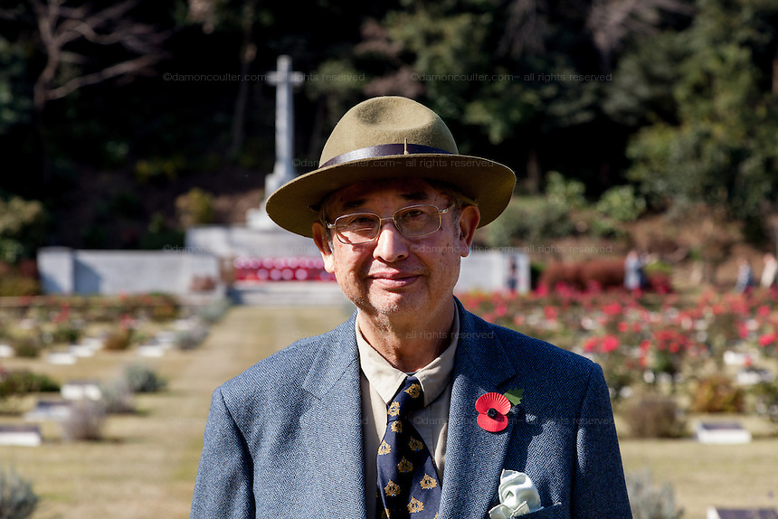 George Okuhara Caswell of the Yokohama Foreign General Cemetery Foundation which manages another  war graves cemetery in Yokohama at the ceremony for Remembrance Sunday at the Commonwealth War Graves Cemetery in Hodogaya, Yokohama, Japan. Sunday November 13th 2016. Each year representatives of the Commonwealth nations, along with American and other European nations that lost servicemen fighting the Japanese in World War 2, hold a multi-faith service of remembrance at this cemetery. This is the only cemetery for war dead in japan that is managed by the Commonwealth War Graves Commission.