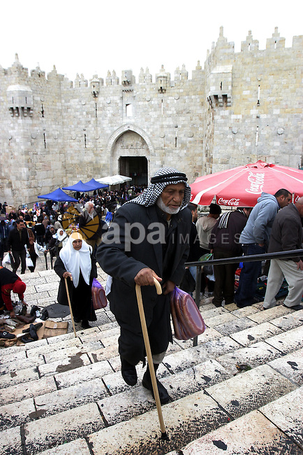 Palestinians walk outside Damascus Gate leading into the old city of Jerusalem from their way from Friday prayers in the Al-Aqsa Mosque compound, Islam's third holiest site, on November 18, 2011. Photo by Mahfouz Abu Turk