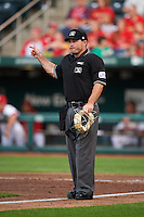 Umpire Mike Cascioppo signals fair ball during a game between the Frisco RoughRiders and Springfield Cardinals on June 3, 2015 at Hammons Field in Springfield, Missouri.  Springfield defeated Frisco 7-2.  (Mike Janes/Four Seam Images)