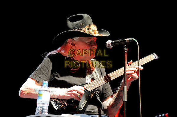 Johnny Winter.performing in concert, Shepherd's Bush Empire, London, England. .14th April 2013.on stage live gig performance music half length guitar black t-shirt profile.CAP/MAR.© Martin Harris/Capital Pictures.